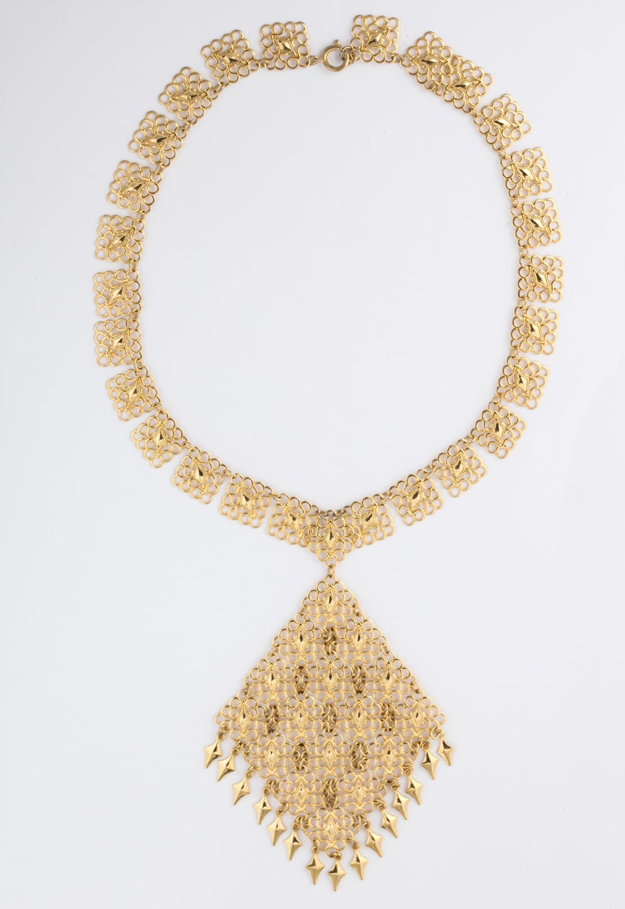 Light and delicate filigree necklace with diamond shaped pendant. 19