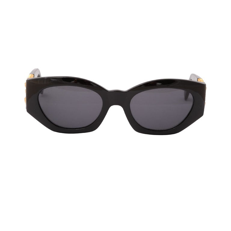 Gianni versace Sunglasses Mod 420/D with gold medusas on the side.
