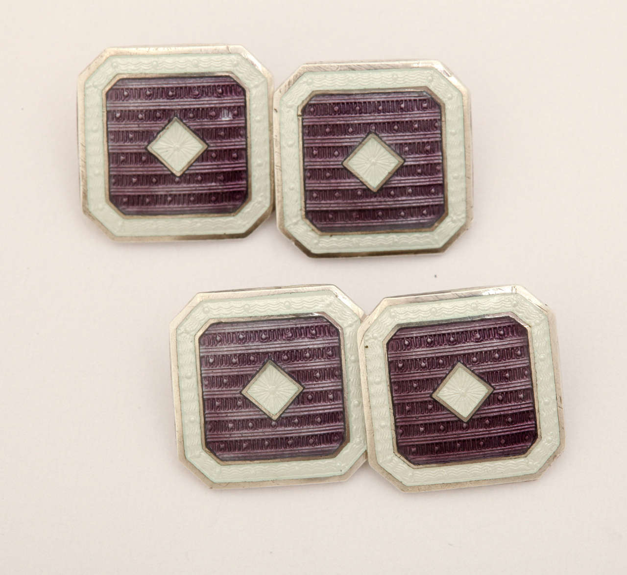 Octagonal with white central diamond surrounded by purple and with a white border. Hallmarks: STERLING