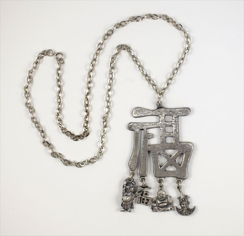 Chunky Chinese character pendant necklace with four dangling charms.