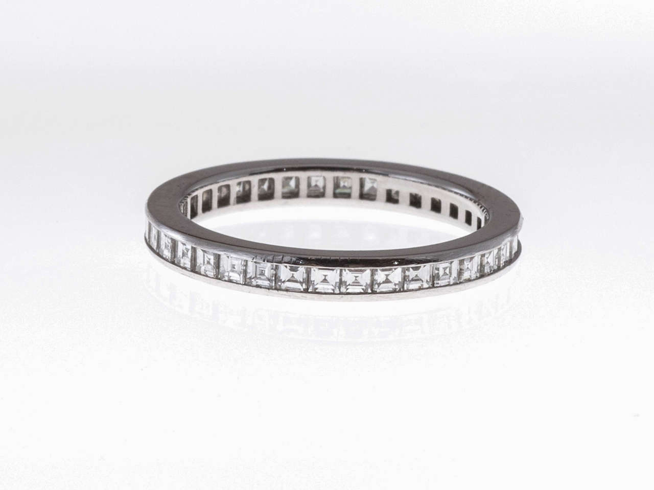 Tiffany & Co. Platinum Eternity ring with fine square diamonds.  Tiffany stamp is a bit faint but correct 3.2 grams 36 square diamonds, approximate total weight .95cts F to G, VS Tested: Platinum Stamped: Tiffany & Co. 95 Size 6 and not