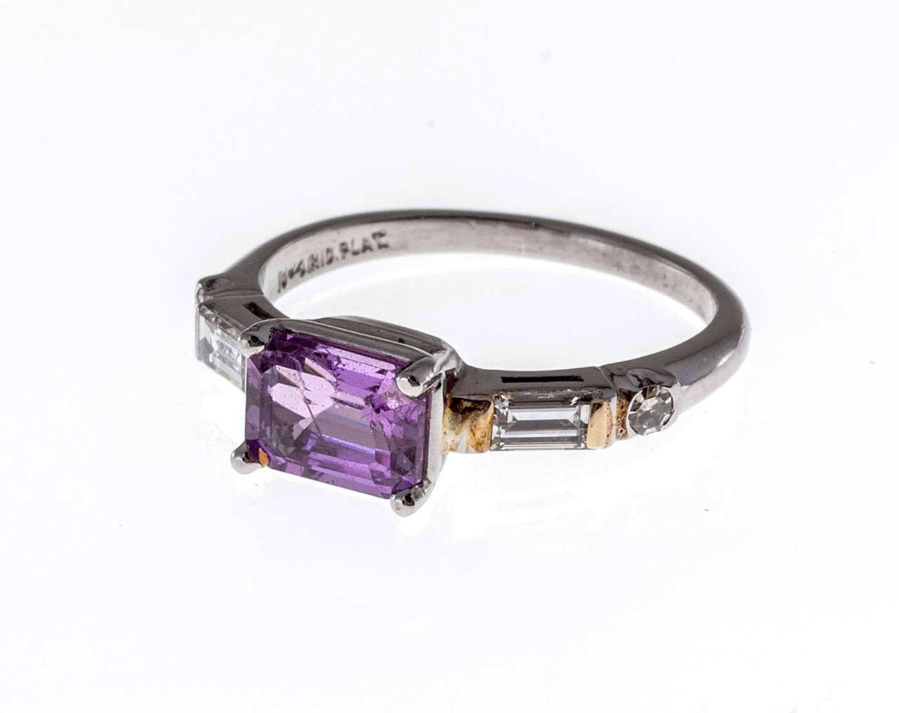 Mid-century 1940-1950 solid Platinum one of a kind ring with fine white diamonds and a super rare one of a kind natural no heat no enhancement purplish pink Sapphire. Strong color saturation. Very rare and beautiful.  1 purplish pink octagonal