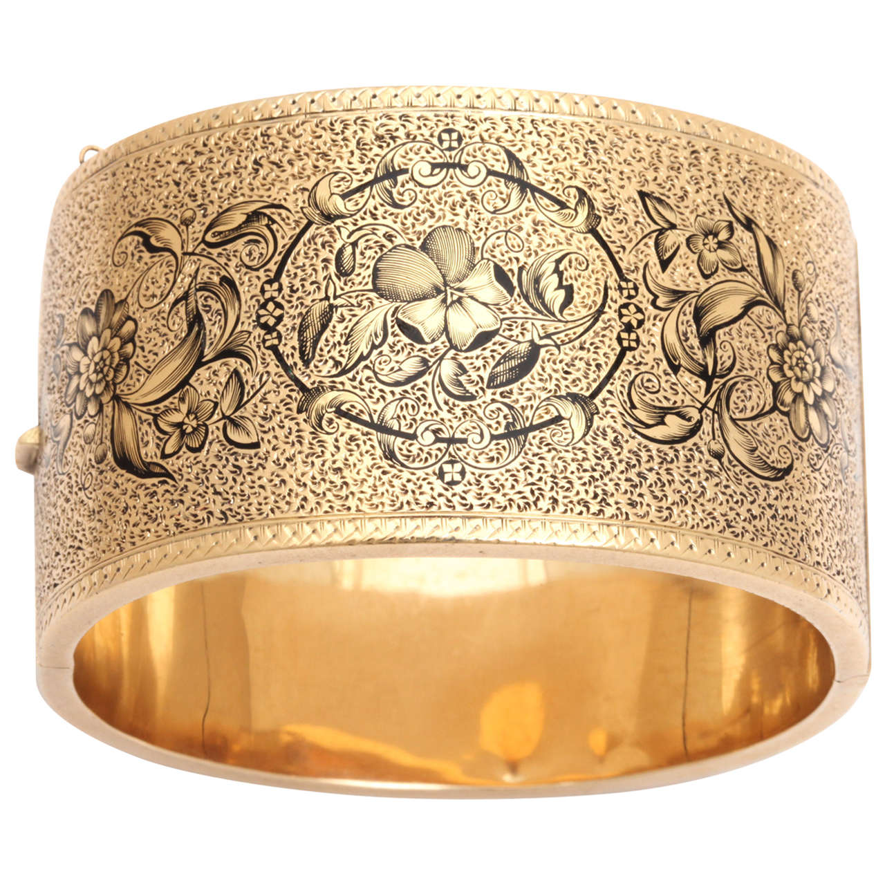a dramatic statement by an antique gold wide cuff bracelet