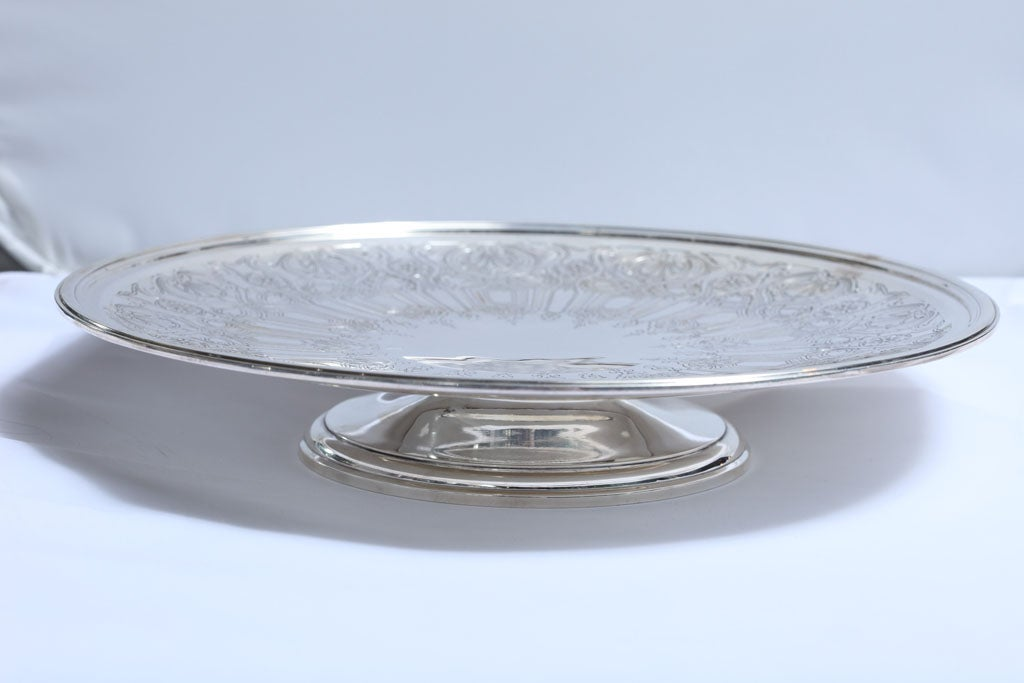 Beautiful, Art Deco, sterling pedestal based serving platter, Tiffany and Co., New York, year-hallmarked for 1923-1924. Approximately 12 1/2 inches in diameter x 2 1/4 inches high. Weighs approximately 38.140 Troy ounces. Beautiful etched pattern.