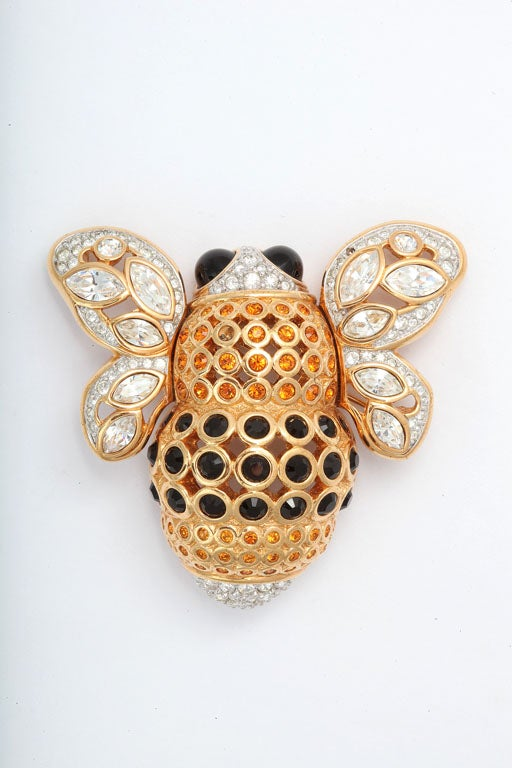 Huge, beautifully detailed goldtone bee brooch decorated with Swarovski crystals. Two small stone are missing.