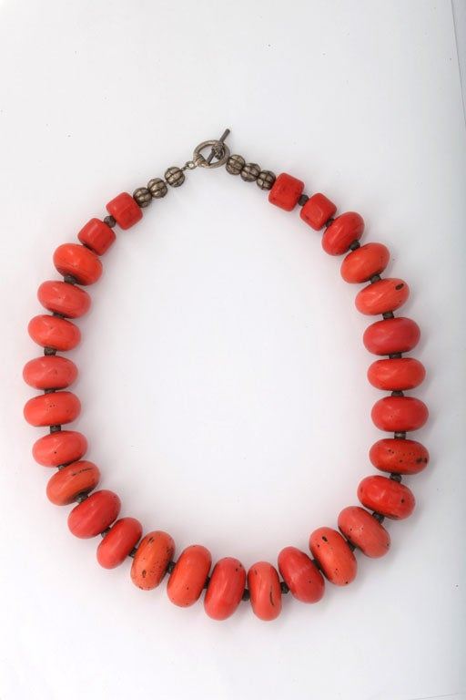 "Graduated coral disk bead necklace. Largest disk bead is 1"" in diameter."