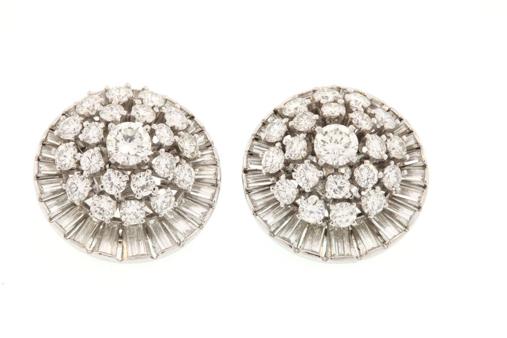Platinum and Diamond Earrings with 42 Brilliant Diamonds and 48 Bagette Diamonds equaling a total of approximately 10 carats.  These earrings sit exceptionally well on the ear.
