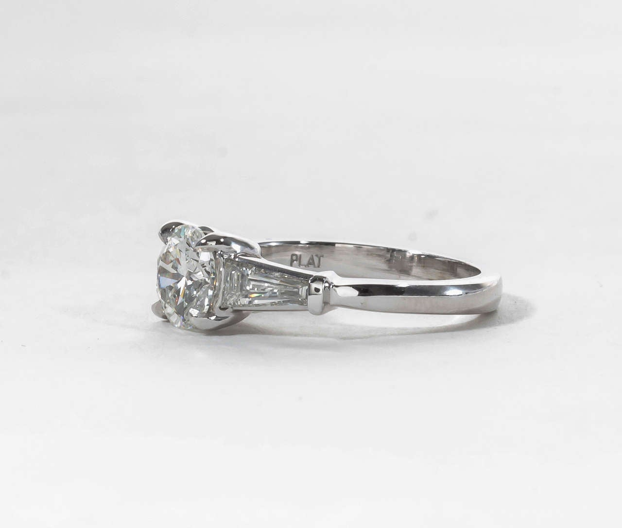 Classic Round Diamond Engagement Ring With Tapered Baguettes 2
