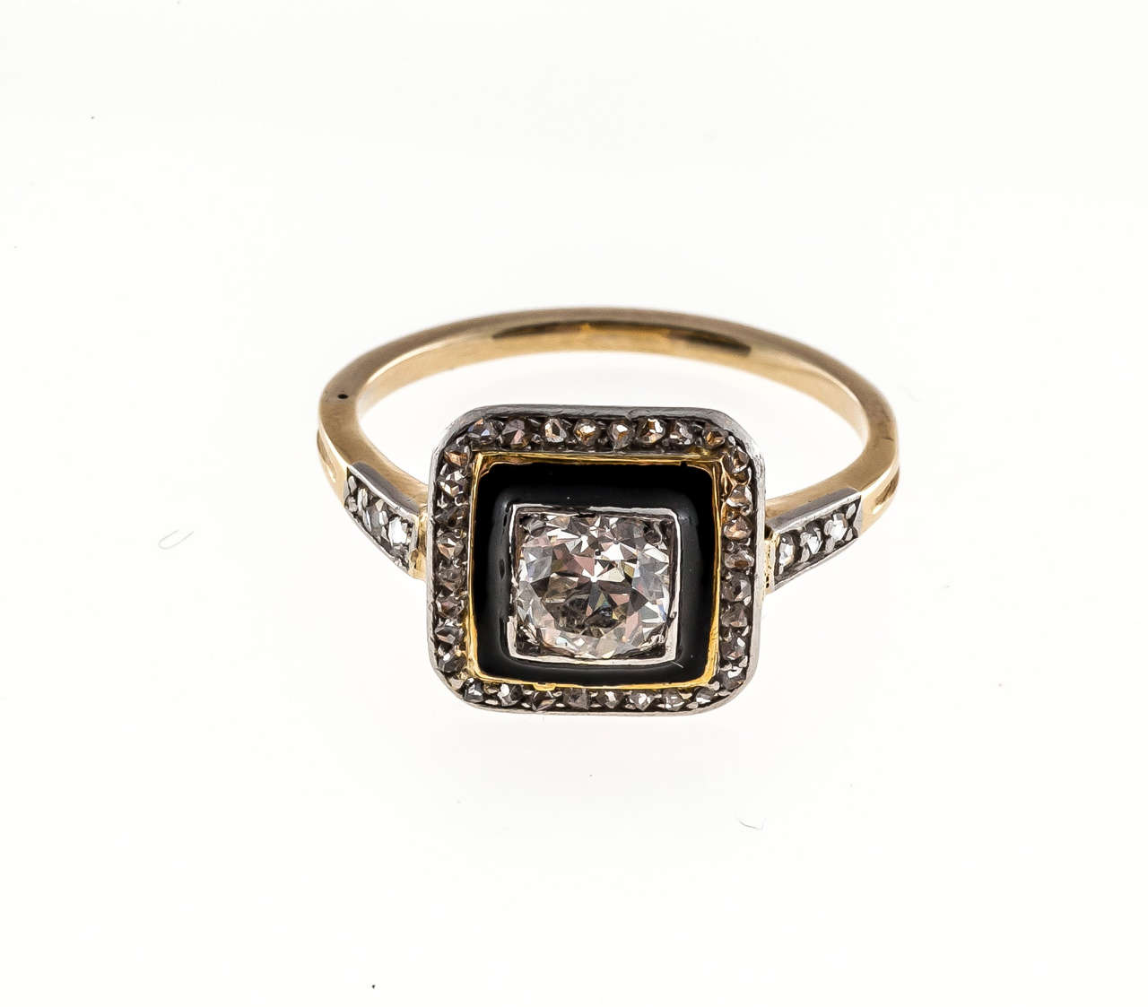 The shoulders and outer rim are set with all original rose cut diamonds.  The center is set with a beautiful well cut European cut diamond.  Around the center diamond is a black enamel rim.  This makes for a striking Art Deco Design.  Very good