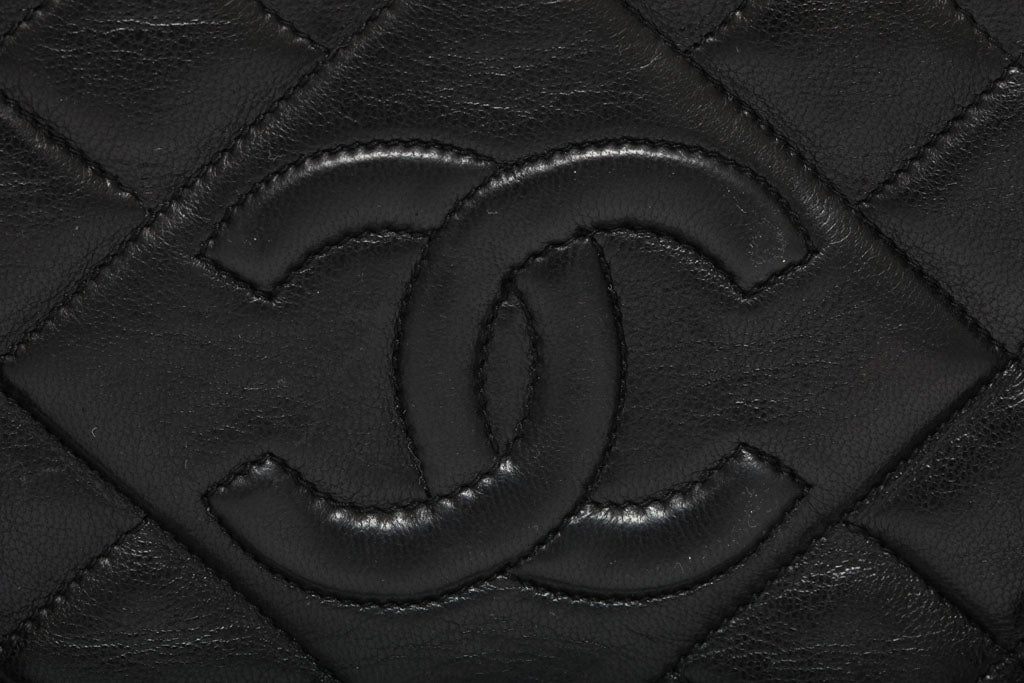 CHANEL BLACK QUILTED BAG WITH TASSEL 3