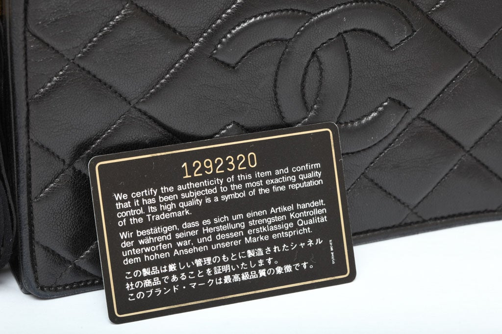 CHANEL BLACK QUILTED BAG WITH TASSEL 8