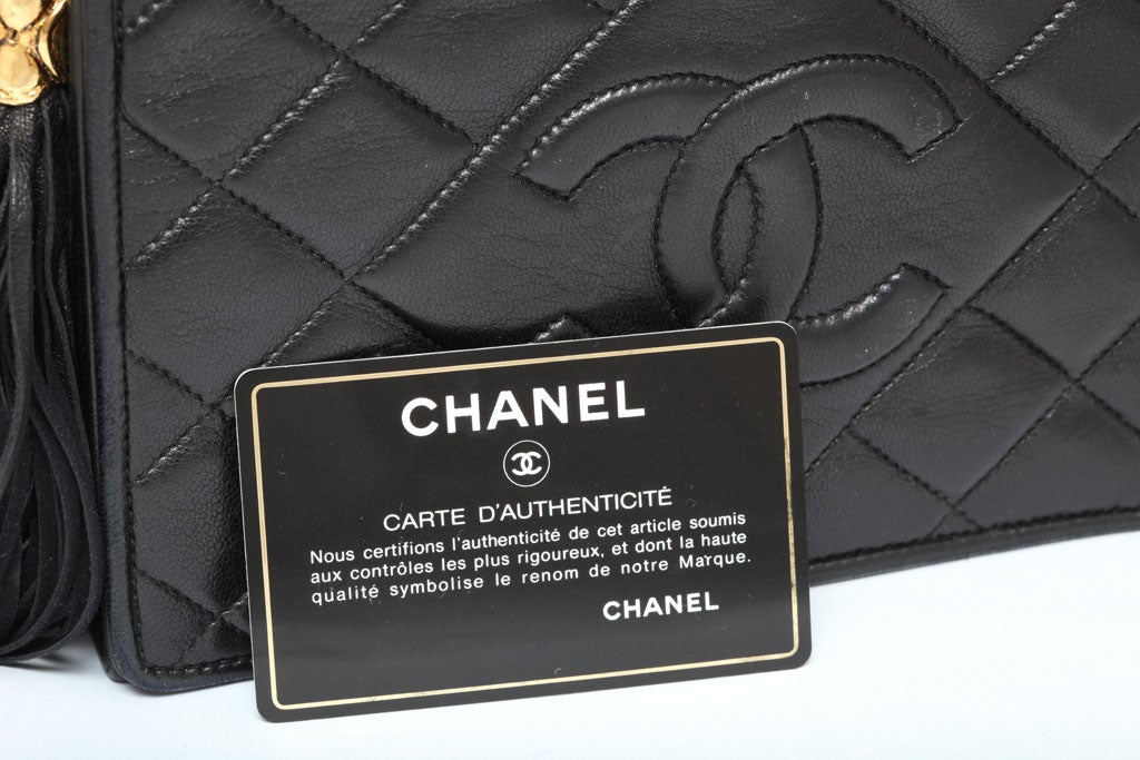 CHANEL BLACK QUILTED BAG WITH TASSEL 9