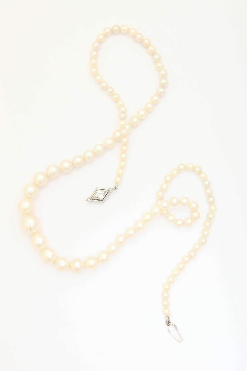 This beautiful vintage (late 40's) cultured pearl necklace has a superb luster as though it's never been worn. There are 96 pearls, with the center pearl being 10 mm graduating to 3-4 mm. Total length is 18 in. The unique clasp is in 14 kt white