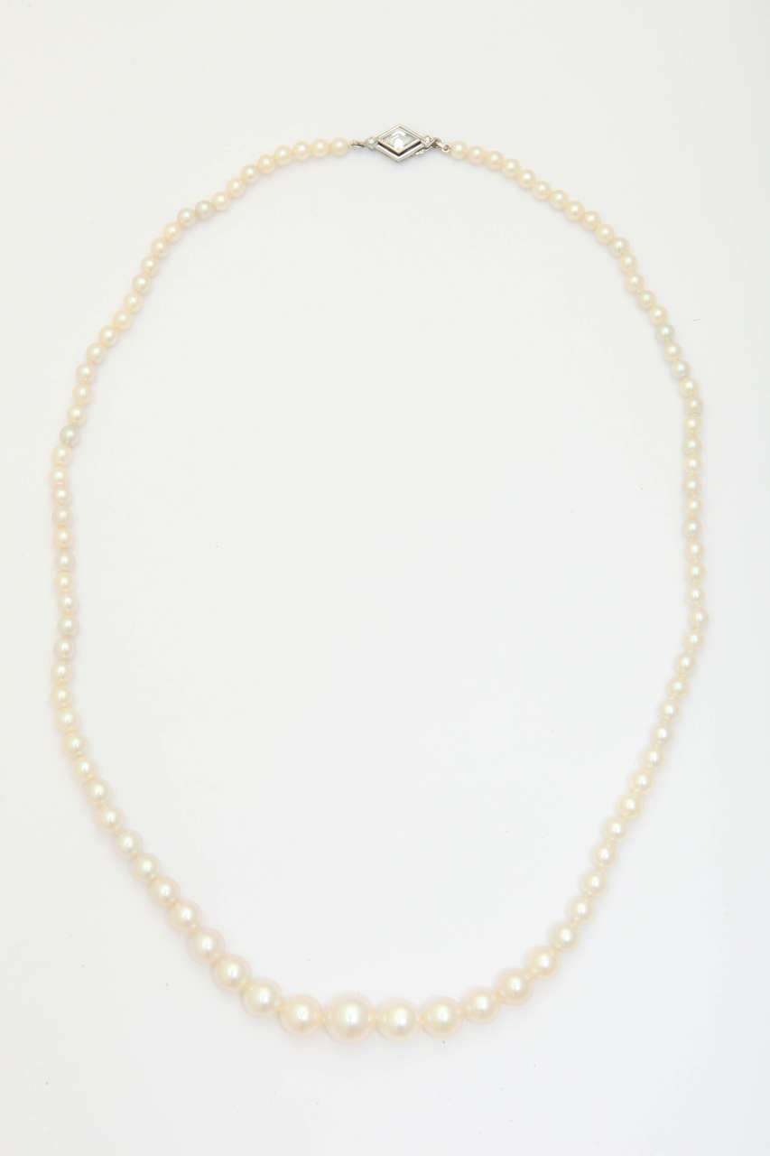 Artisan Graduated Cultured Pearl Necklace with Diamond Gold Clasp For Sale