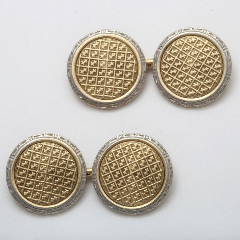 American Art Deco 14K gold cufflinks with central yellow gold grid design surrounded by white gold patterned border.  Hallmark: 14K