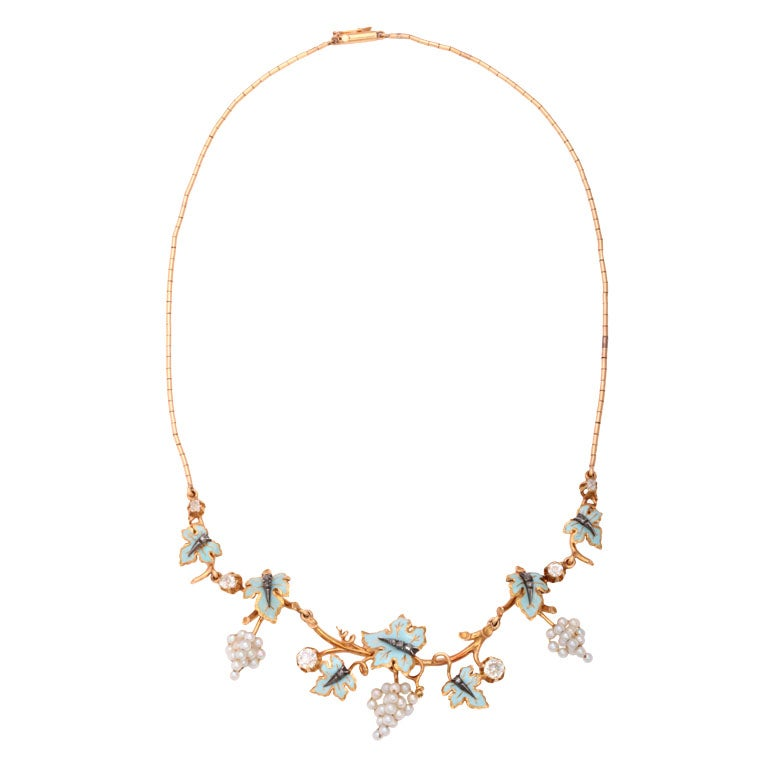 Exquisite Victorian Natural Pearl and Diamond Necklace featuring a graduating floral design centrally set with six old mine diamonds interspersed  with polychrome enamel  foliage studded with rose cut diamonds, accented by stylized grape pendants