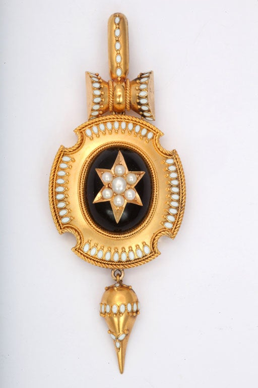 Striking and beautifully different are thoughts that come to mind when you see this pendant. The gold is warm, 15kt and rich.  It enhances the white of the pearls and accents of white enamel.  The enameling is perfect.  The bale and suspended drop