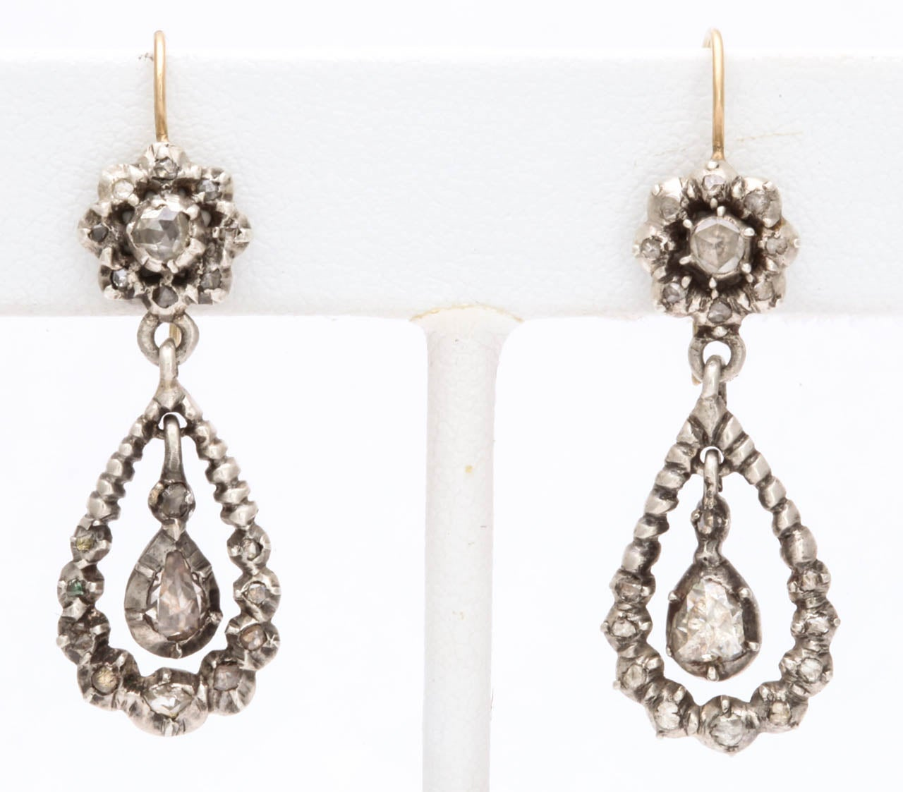 Brilliant and  glistening foiled old cut diamonds, hand cut and polished, show that each stone is individually shaped and set.   This is important in determining the age of antique jewelry and one reason why Georgian jewelry is desired.  All