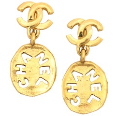 Chanel Logo Cutout Dangling Earrings