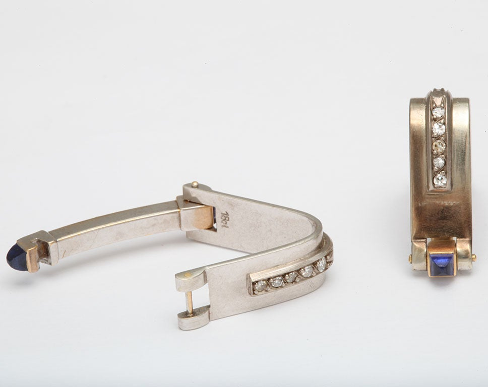 white gold stirup cufflinks with sapphires and diamonds at