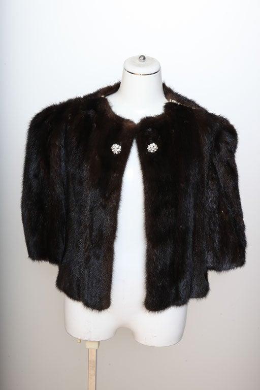 Dark brown mink fur coat with rhinestones.<br /> Size S-M.