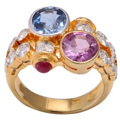Pink and Blue Sapphire Gold Crossover Ring with Diamonds and Ruby Accents