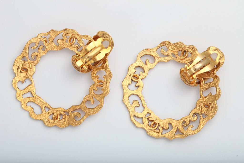 Women's  Chanel Gold Tone Hoop Earrings with CC Logos For Sale