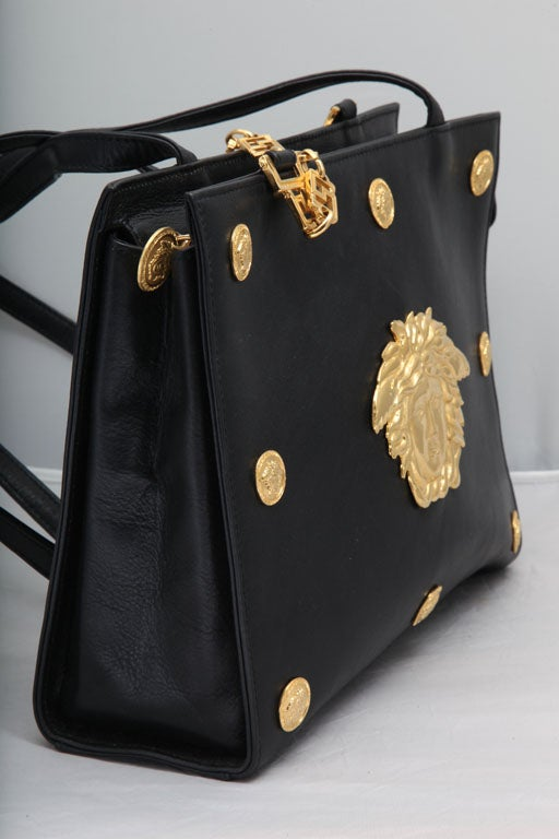 Extremely rare Gianni Versace Couture shoulder bag with iconic Medusa motifs. Shoulder drop 18 inches