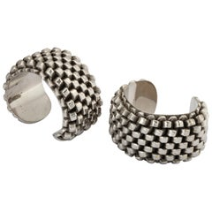 """Pair of """"Machine Age"""" Silver-Plated Bangles"""