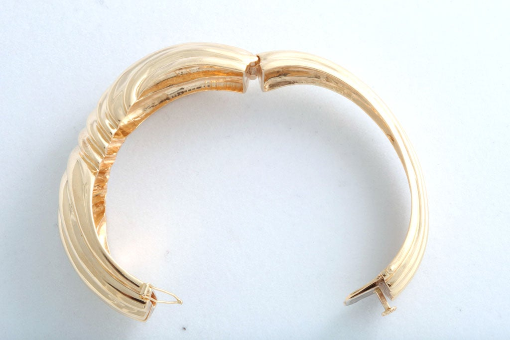 Beautifully made in the 1970s, this 14k yellow gold has a 3D ribbed bow design.   Inside the bracelet measurements are 1.25