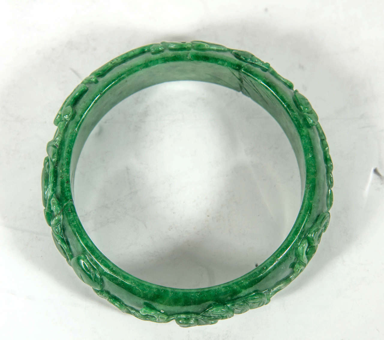 Exquisite Hand Carved Chinese Stylized Floral Scroll Design Stone Bangle In Excellent Condition For Sale In New York, NY