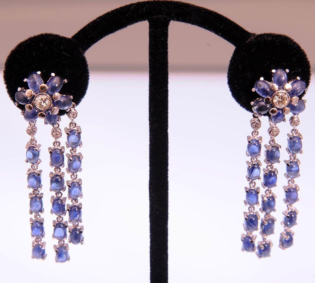 Incredible sapphire and diamond earrings that move with the wearer.