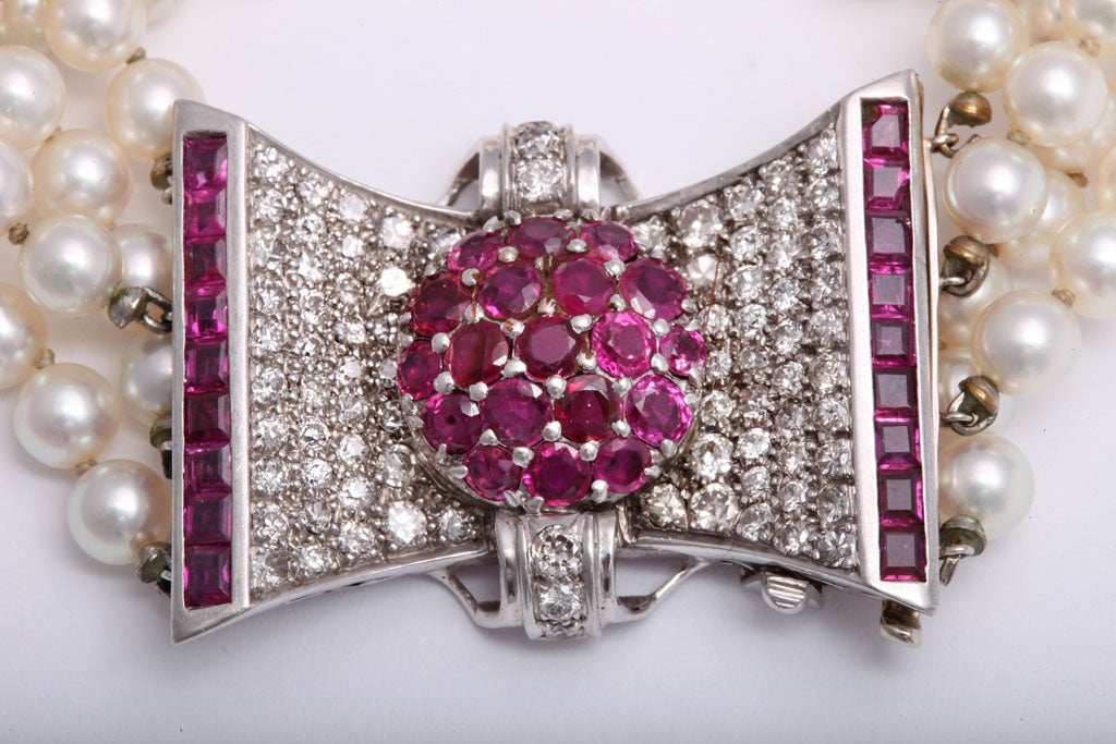 Retro Diamond and Ruby Bow Four Strands of Cultured Pearl Bracelet In Excellent Condition For Sale In Miami Beach, FL