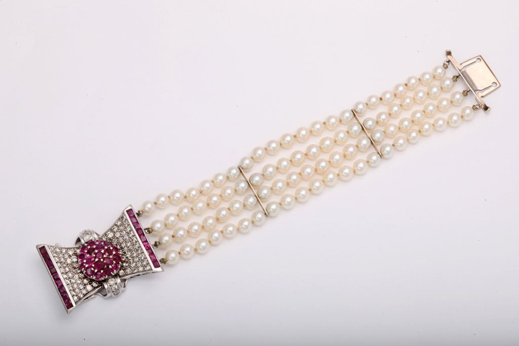 Women's Retro Diamond and Ruby Bow Four Strands of Cultured Pearl Bracelet For Sale