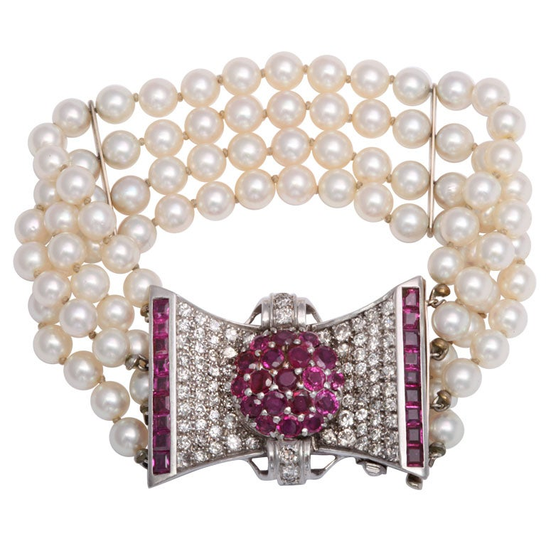 Retro Diamond and Ruby Bow Four Strands of Cultured Pearl Bracelet For Sale