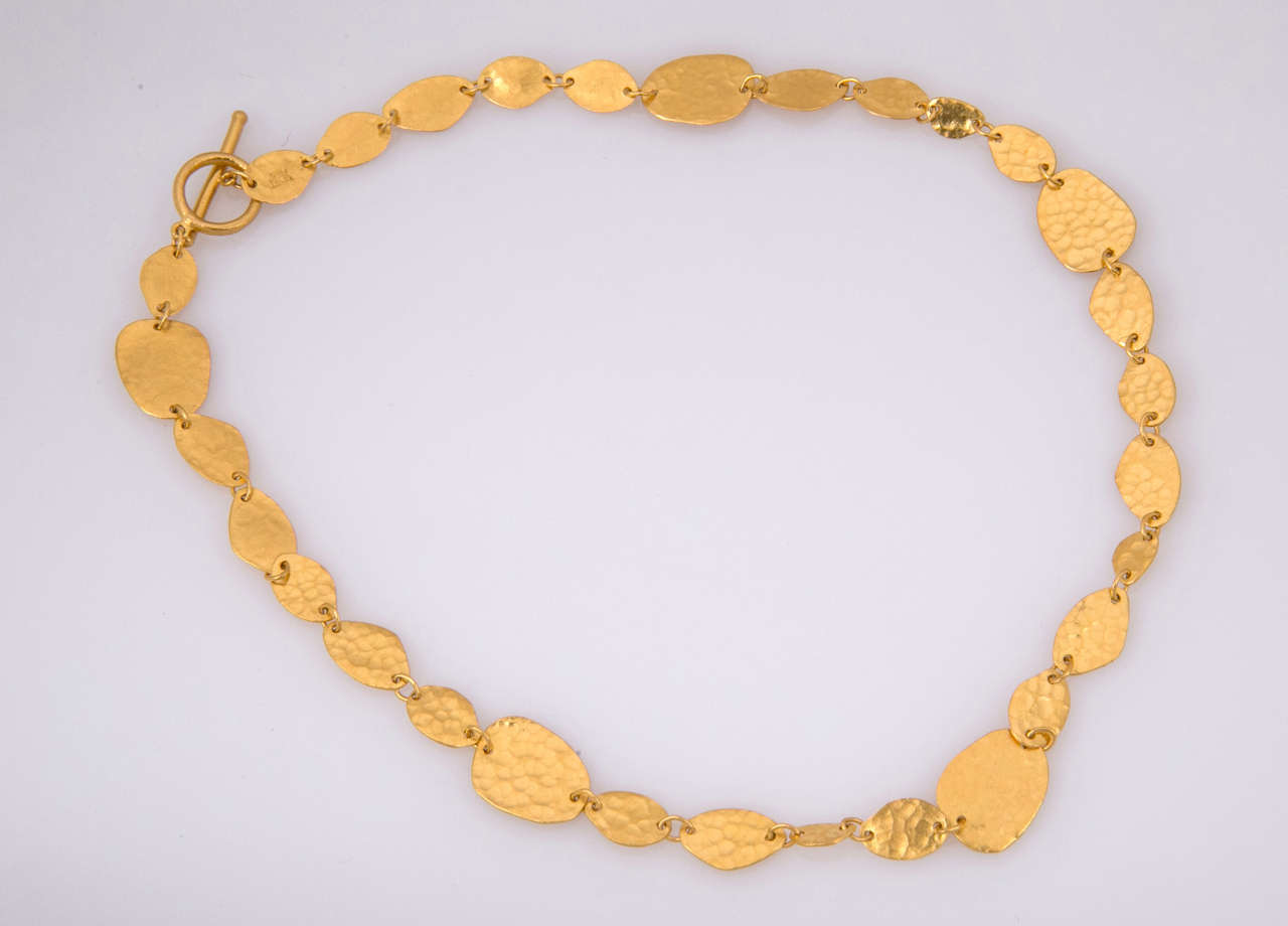 Yossi Harari 24kt Gold Necklace.  Hand wrought and hammered disk shaped 24kt necklace by iconic designer yossi Harari. Signed