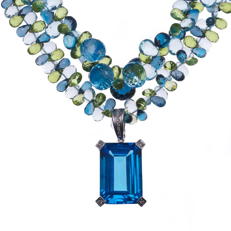 100 Carat Blue Topaz Pendant in White Gold and Diamonds on a Multi-Strand Necklace of London Blue Topaz, Swiss Blue Topaz, Peridot and Sterling Silver