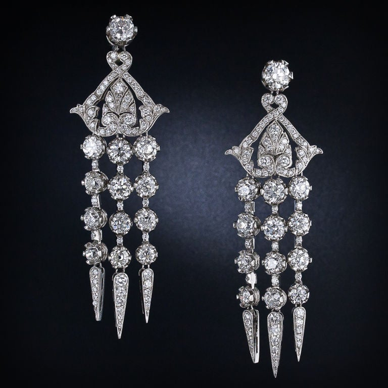 These exotic and exemplary long drop, or 'chandelier' earrings were handmade using mainly old-cut diamonds in fabulous late-Edwardian/early Art-Deco style. Three sparkling rows of diamonds swing and sway below a styled pagoda top which, in turn,