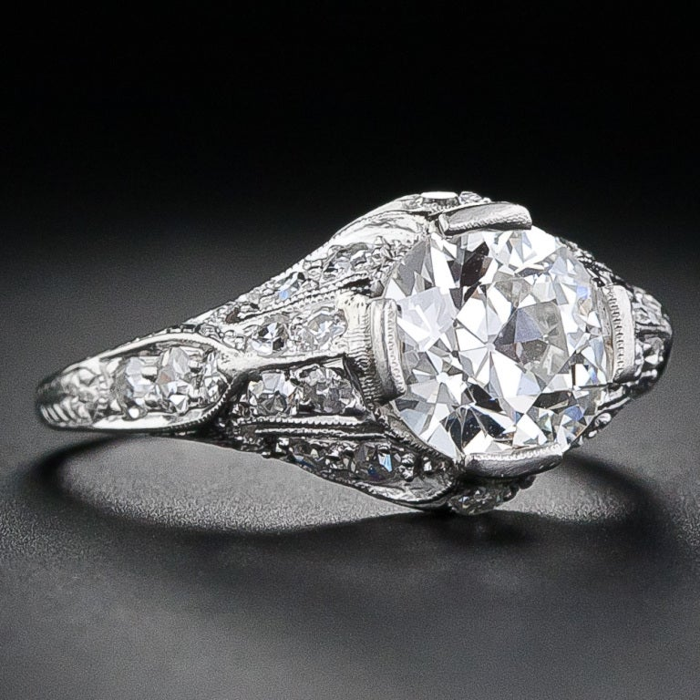 This exceptional, ravishing and original Edwardian diamond engagement ring was finely hand fabricated in platinum during the first one or two decades of the twentieth century. A bright-white, high-quality 1.60 carat European-cut diamond radiates