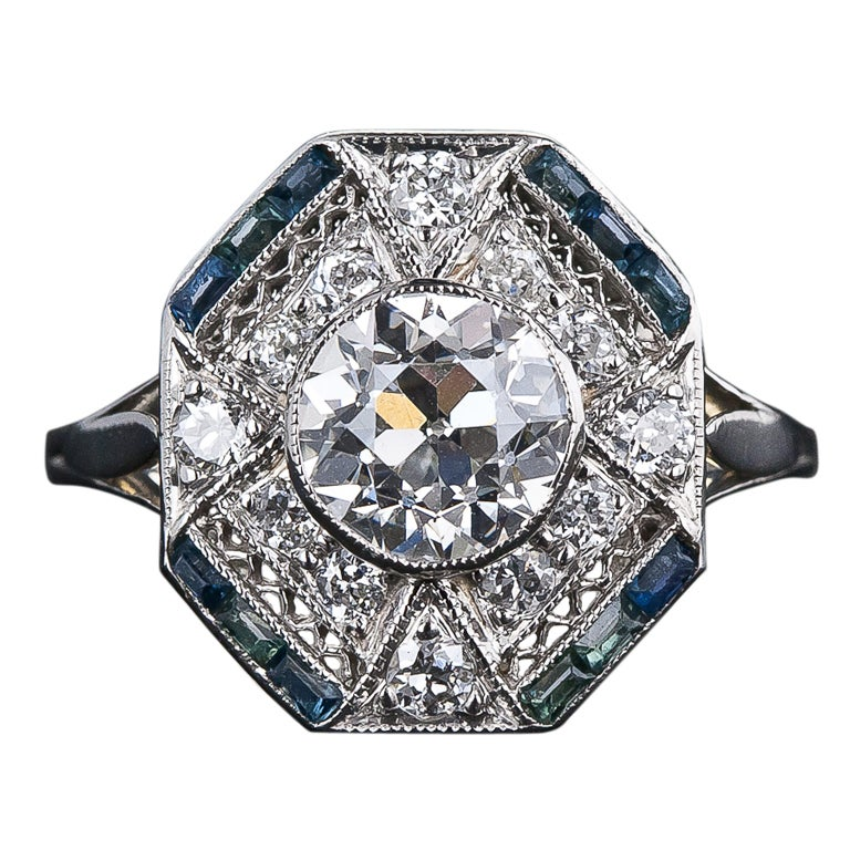 1.28 Carat Diamond and Calibre Sapphire Art Deco Ring For Sale