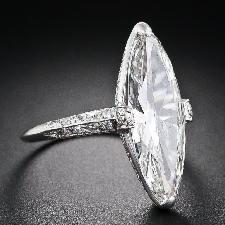 A sparkling and streamlined, early twentieth-century vintage marquise diamond, weighing just two points shy of four carats and measuring 7/8 inch long (!) (about the length of a regular cut 7.00 carat marquise) is presented in an elegantly