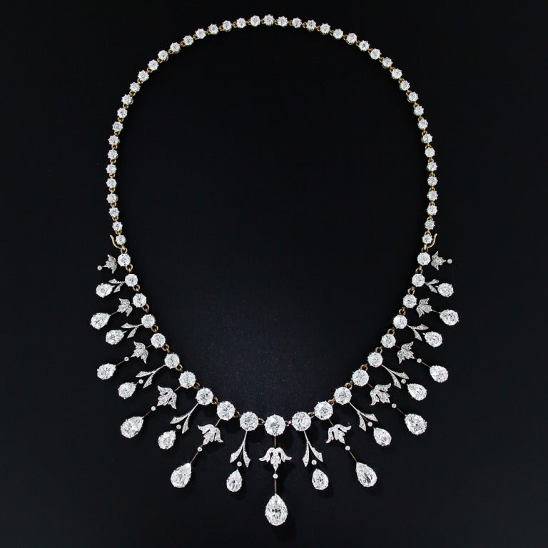 We are thrilled to present this rare, regal and altogether sublime antique diamond necklace. A masterpiece of Edwardian craftsmanship - circa 1900 - hand-fabricated in platinum over 18 karat gold, with almost 35 carats of well-matched, bright-white