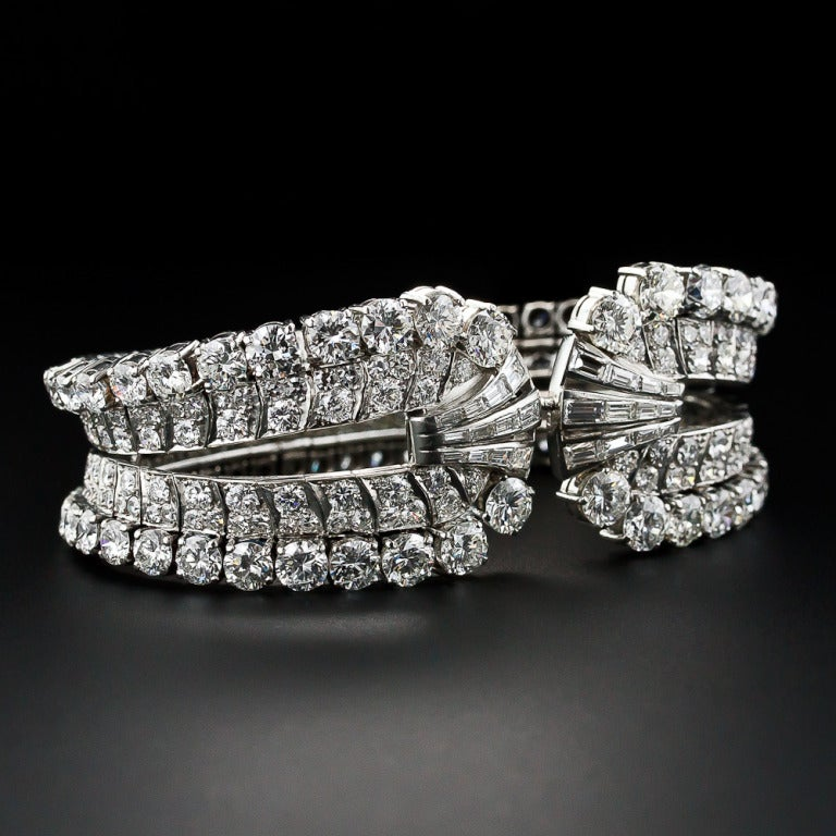 A spectacular, singular and showstopping diamond bracelet with an exotic pedigree. Twenty-eight carats of bright-white and sparkling round diamonds culminate in the center with sprays of baguettes and is masterfully handcrafted in platinum with