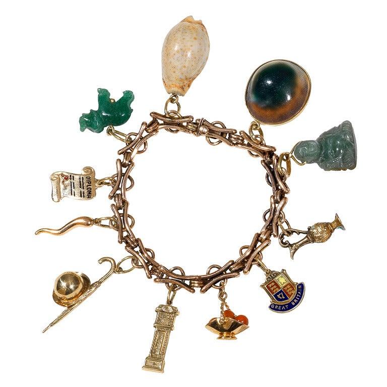 A Shell Enamel Coral Jade Gold Charm Bracelet