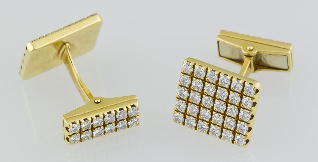 Bold and elegant 18K gold and diamond cufflinks by Piaget. They feature approx. 3.0cts of high quality round cut diamonds, both front and back.<br />
