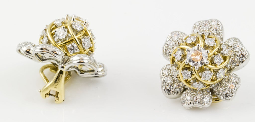 Tiffany & Co. Schulmberger Diamond Gold Platinum Flower Earrings In Excellent Condition For Sale In New York, NY