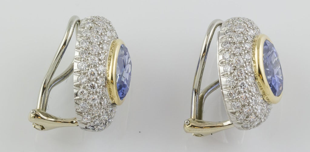 Rare vibrant sapphire diamond platinum & 18K yellow gold earrings by Angela Cummings, circa 1980s. They feature platinum mounts, with 18K gold bezel surrounding a rich blue natural Ceylon (Sri Lanka)  sapphires that measures:  5.39cts on one ear