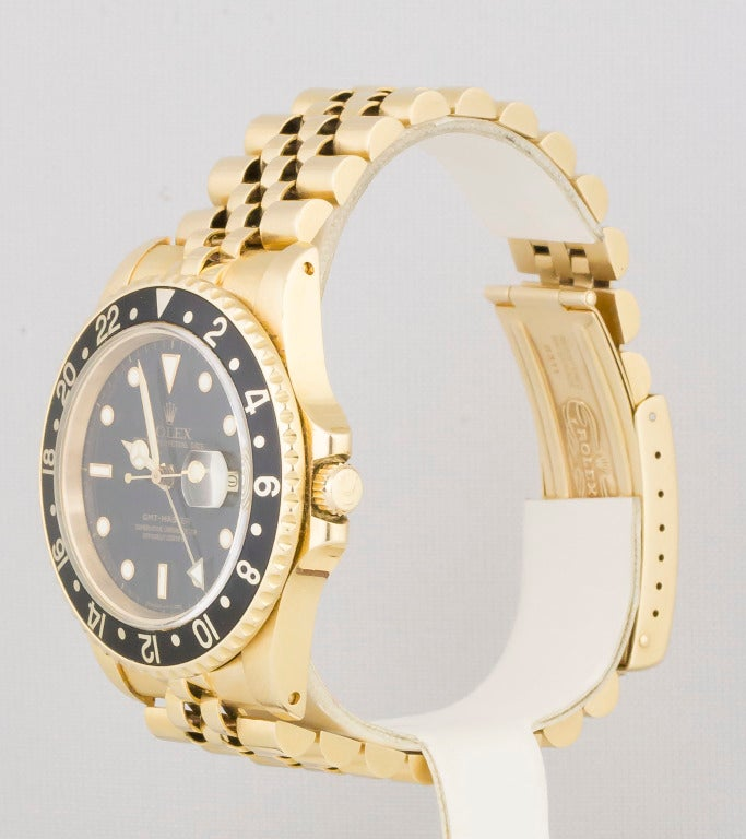 Highly sought after Rolex 18k yellow gold GMT-Master wristwatch. It features a sapphire crystal and quickset date. Automatic movement. Comes with Rolex 18k yellow gold Jubilee bracelet with deployant clasp.