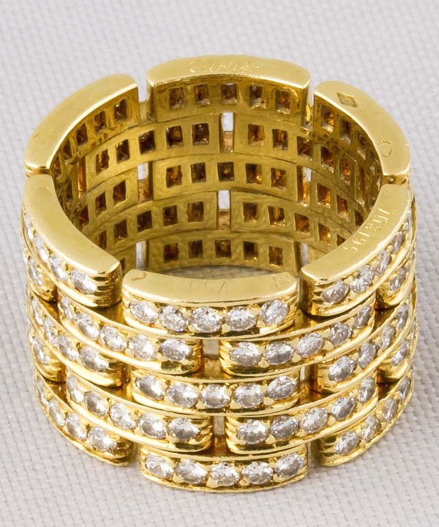 Beautiful and impressive 18k gold and diamond band, from the timeless