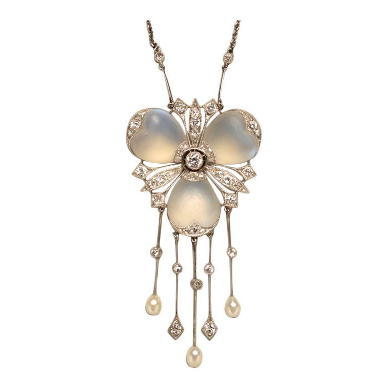 A Delicate Diamond and Moonstone Platinum Pendant 1